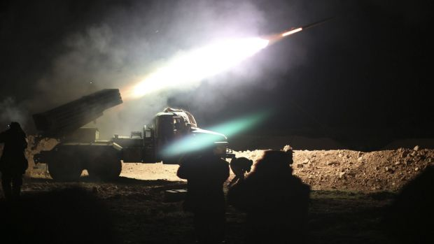 Soldiers from the Syrian army fire a rocket at Islamic State group positions in the province of Raqqa.