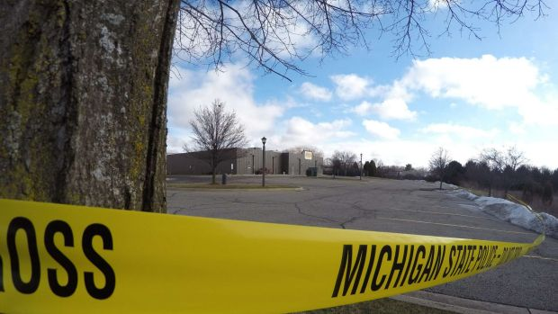 Police tape surrounds one of the crime scenes in Kalamazoo, Michigan on Sunday.
