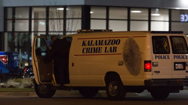 An officer with the Kalamazoo Crime Lab leaves the scene of one of the random shootings.