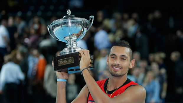Winner: Nick Kyrgios holds his trophy after beating Marin Cilic.