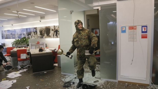 Right-wing paramilitary veterans in Ukraine attacked two offices of Russian banks in the capital amid observances of the ...