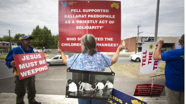 Protestors against child abuse within the Catholic Church stand out the front of the Ballarat Magistrate's Court before ...