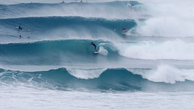Some surfers are taking on the wild conditions but surf life savers have warned against it.