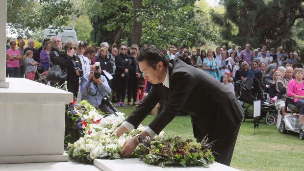 Japanese Parliamentary Vice-Minister for Foreign Affairs Hitoshi Kikawada offers flowers during a memorial ceremony in ...