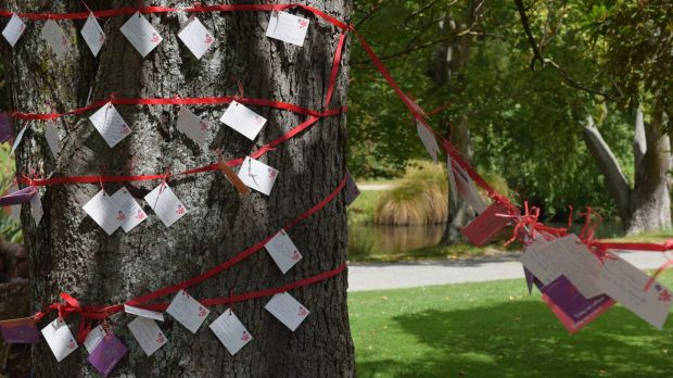 Messages are left on a tree after a memorial service held on Monday in Christchurch's Botanical Gardens for victims of ...