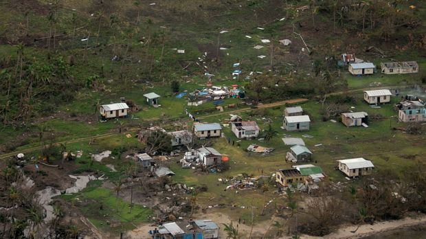 Debris scattered around damaged buildings at Nakama settlement in Fiji after Cyclone Winston.