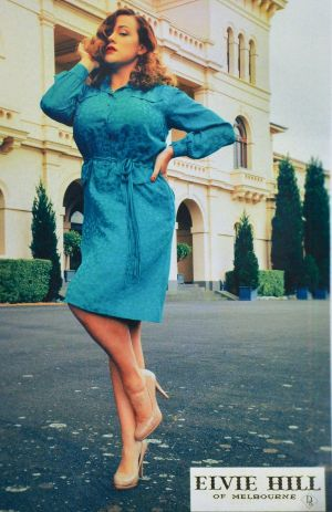 A model wearing an Elvie Hill dress, with the image processed to look old.