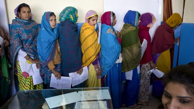 Women line up for examinations before sterilisation surgery at a government hospital in Mahendragarh, India, earlier ...