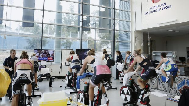 Cyclists at the Australian Institute of Sport physiology lab during tests to measure the effects of calcium loading on ...