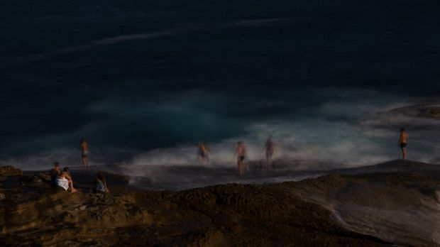 Swimmers cool off in the large swell off the rock ledge at the north end of Maroubra.