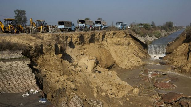 A damaged section of the Munak canal. Fears of a water crisis in the Indian capital eased on Monday after security ...