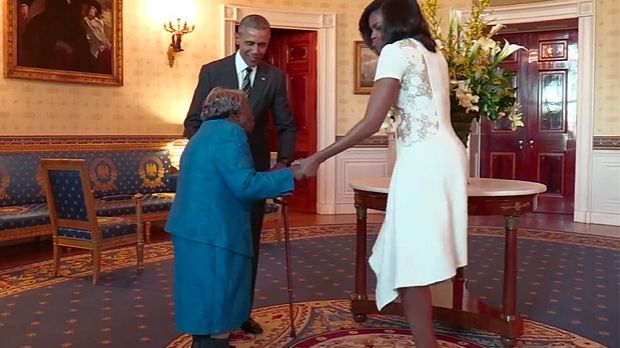 """I tell you, I am so happy,"" she said, looking up at Barack Obama before turning to the first lady. ""A black president, ..."
