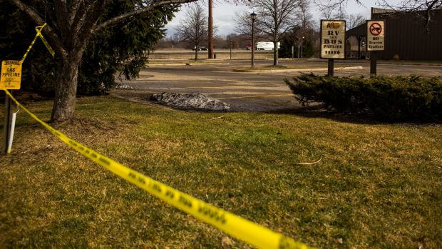 Police tape is seen outside a Cracker Barrel restaurant in Kalamazoo, Michigan on Sunday.