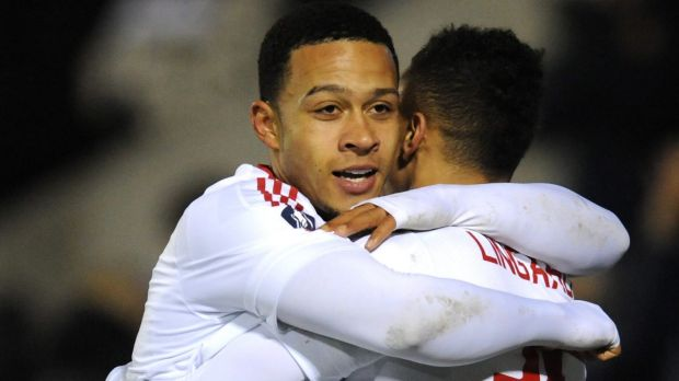 Jesse Lingard, right, is congratulated by Memphis Depay.