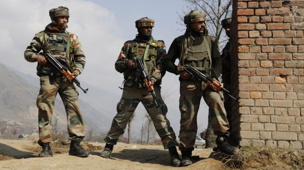 Indian Army soldiers during a gun battle with Kashmiri rebels in Pampore, near Srinagar, Kashmir, on Monday.