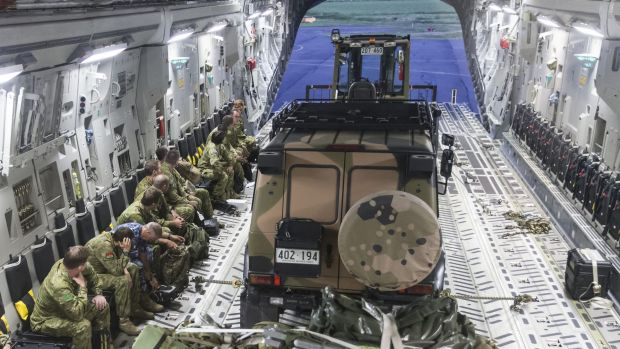 Members of Australia's reconnaisance and assessment team prepare to disembark a RAAF C-17A Globemaster aircraft at the ...