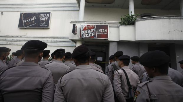 Indonesian police outside a 'cafe' in Kalijodo.