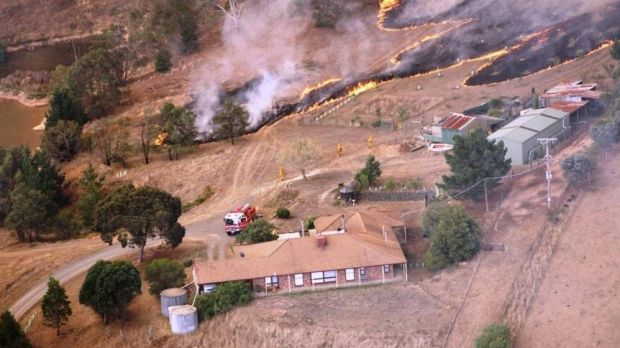 The bushfire threatens a home at Mount Bolton.