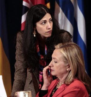 Huma Abedin, top, then-deputy chief of staff and aide to Secretary of State Hillary Rodham Clinton, in 2011.