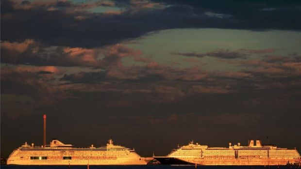 Two ships pass at Port Melbourne on Tuesday evening.