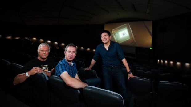 ANU Film Group members, from left,  Brett Yeats, secretary Andrew Wellington and President Adrian Ma, in the Coombs Theatre.