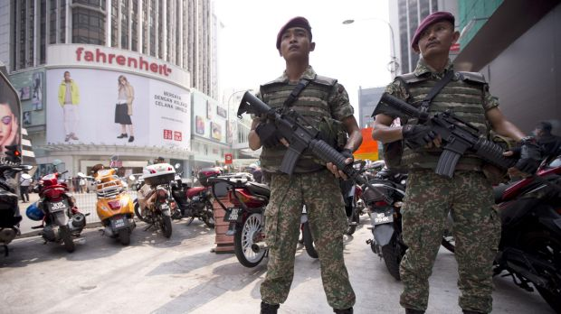 Soldiers stand guard before the arrival of Malaysian Prime Minister Najib Razak for a joint police-army exercise in ...