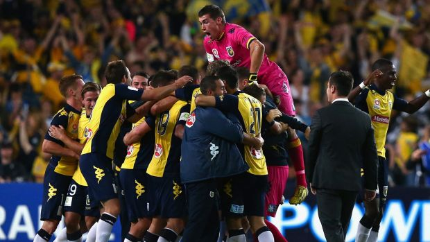 No home-ground advantage: the Mariners celebrate winning the grand final against the Western Sydney Wanderers at Allianz ...