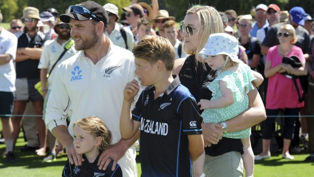 New Zealand's captain Brendon McCullum stands with his wife Elissa and children after the Test ended on Wednesday.