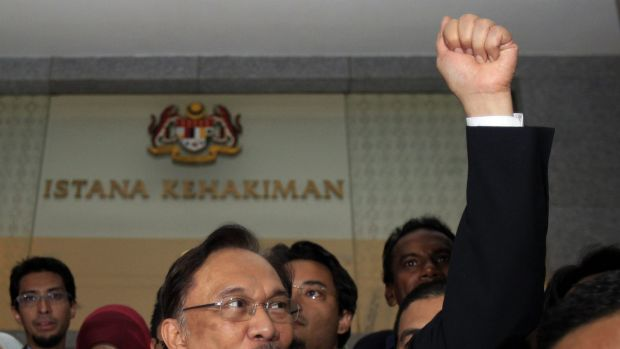 Former deputy prime minister Anwar Ibrahim is serving a five-year jail sentence of what he says are politically ...