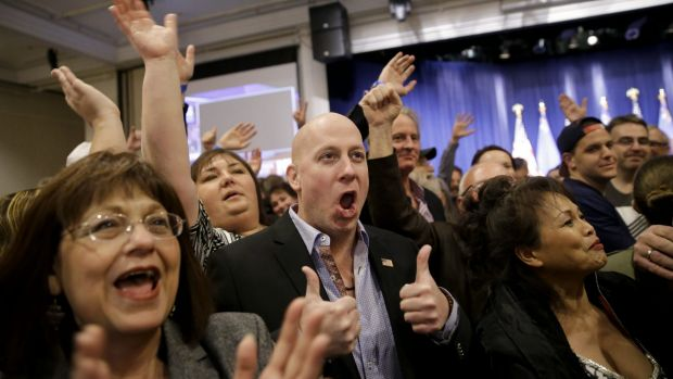 Angry voters align with Trump camp: Supporters cheer during a caucus night rally for Donald Trump.