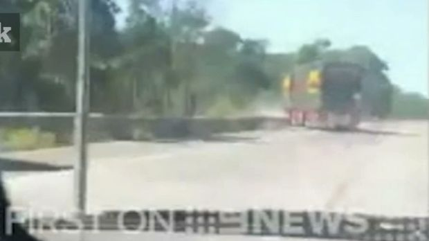 The woman filmed as the truck swerved over the road before crashing down the embankment.