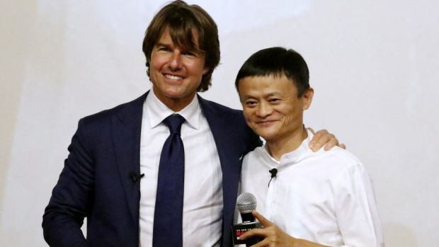 Tom Cruise and Alibaba chief executive Jack Ma, who has slipped to fourth on China's rich list, at the Shanghai premiere ...