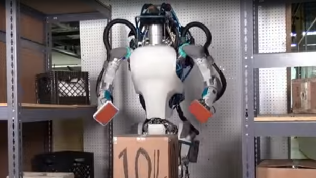 An Atlas picks up a box in the Boston Dynamics video.