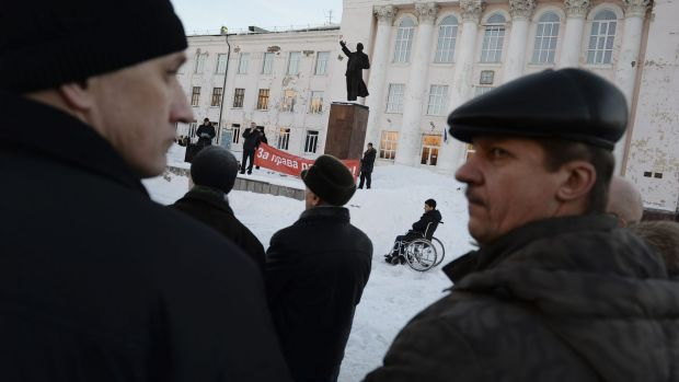 People attend a workers rights protest in the factory town of Nizhny Tagil, Russia.