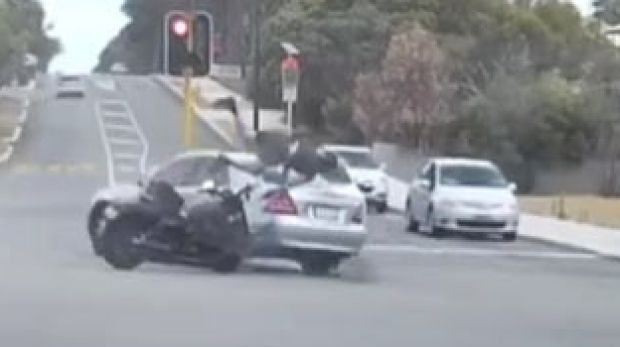 Dash cam video captures the moment a motorcyclist slams into a car in East Vic Park.
