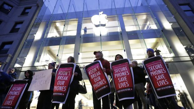 Demonstrators in Boston protest the FBI attempts to require Apple to make it easier to unlock an encrypted iPhone.