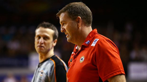 Far from happy: Wildcats coach Trevor Gleeson exchanges words with a referee during the NBL semi-final match between the ...