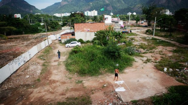 Destroyed: Residents stand in the mostly demolished Vila Autodromo favela community, a former fishing colony in Rio de ...