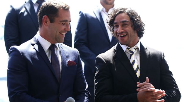 Friendly rivals: Cameron Smith and Johnathan Thurston share a joke on stage during the 2016 NRL season launch at Sydney ...