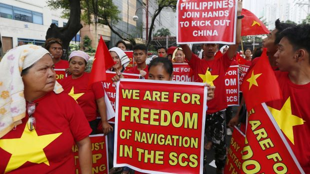 Filipinos, with Vietnamese expatriates, rally at the Chinese Consulate to protest against China's island-building and ...