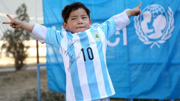 Murtaza Ahmadi shows off the signed shirt sent to him by Lionel Messi.