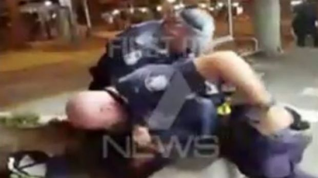 Gold Coast police arrest a man at Surfers Paradise.