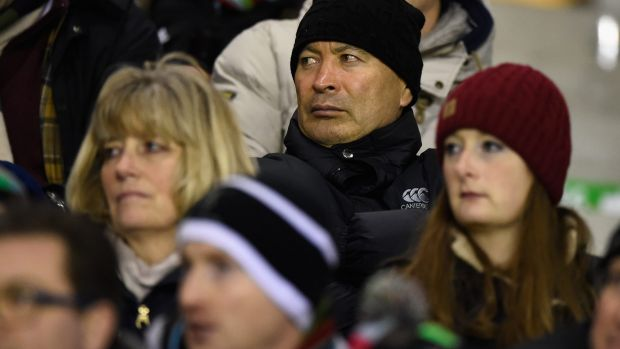 Keeping a low profile: Eddie Jones watches Harlequins take on Leicester Tigers in the stands last weekend.