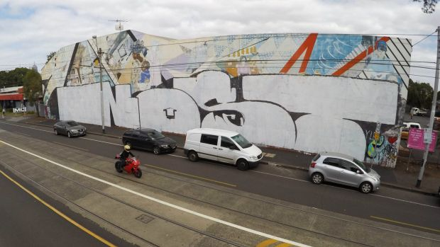 The historic Northcote mural after being tagged by Nost.