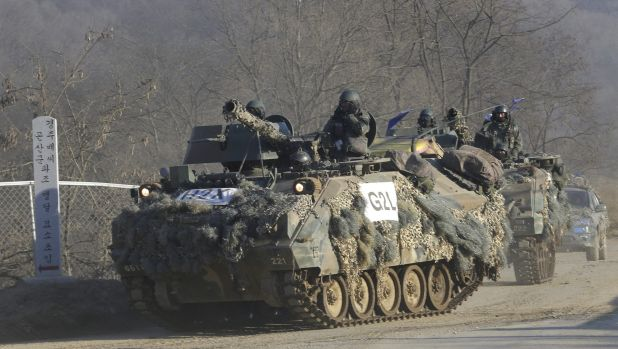 South Korean armoured vehicles on the move during the annual exercise against a possible North Korean attack in Paju, ...