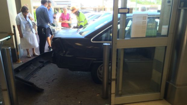 A car has crashed into a shopping complex at Kenmore.