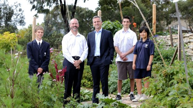 Templestowe College principal Peter Hutton, left, and Swinburne engagement officer Andrew Smith with college students, ...