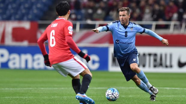 Gliding across the turf: Milos Dimitrijevic runs with the ball during the AFC Champions League Group H match between ...