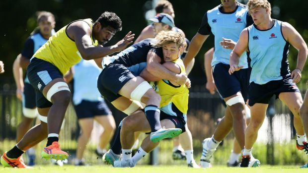 Crunch time: Michael Hooper is tackled during a Waratahs training session at Kippax Lake.