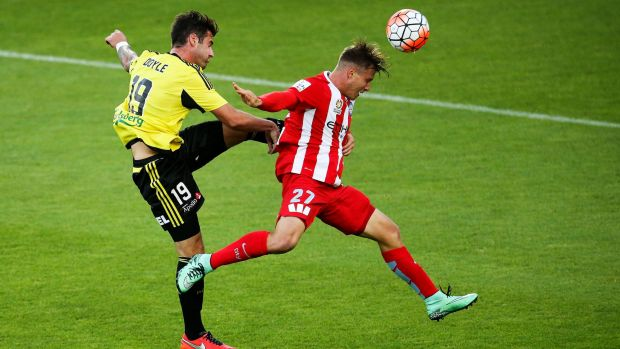 Tom Doyle of the Phoenix and Nick Fitzgerald of Melbourne City compete for the ball.